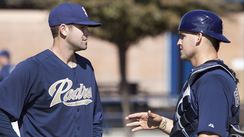 Yasmani Grandal (right, with Casey Kelly) plated 68 runs in 105 games in 2011.